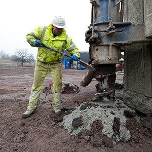 Employee carrying out ground improvement works