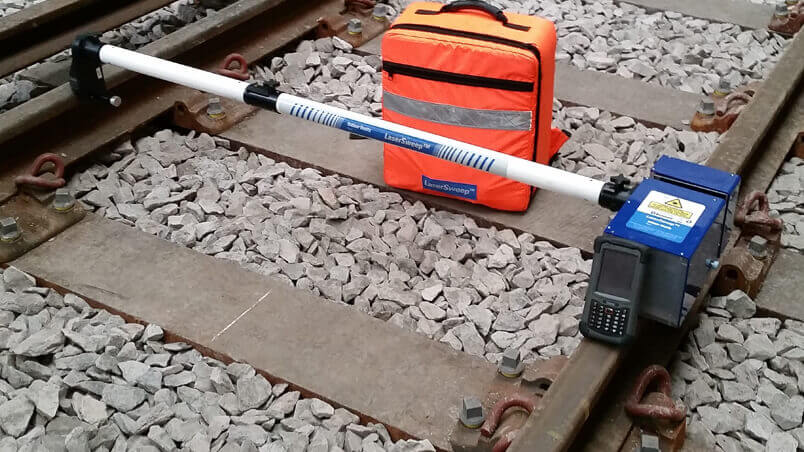 Balfour Beatty's Lasersweep measuring device set up on a section of track