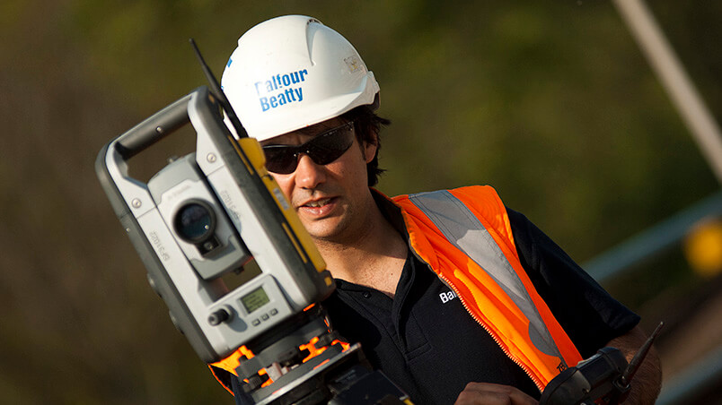 Person operating surveying equipment
